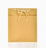 Brown paper bag. Tie in ribbon bow knot with rope Royalty Free Stock Images