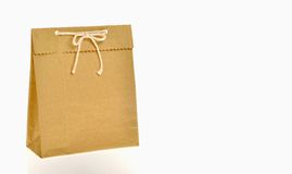 Brown paper bag. Tie in ribbon bow knot with rope royalty free stock photo
