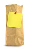 Brown paper bag with yellow note Royalty Free Stock Images