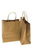 Brown paper bags. Two old brown paper bags isolated against a white background Royalty Free Stock Photography