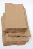 Brown paper bags. A group of brown paper bags on white Stock Photos