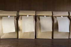 Brown paper bags with hanging labels Royalty Free Stock Image