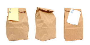 Brown paper lunch bags, notepaper, isolated on white background Stock Photography