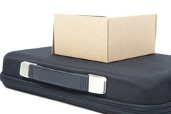Brown paper box on a black briefcase. Royalty Free Stock Photo