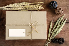 Brown paper box on old wood background with dried flower Stock Image