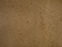 Brown paper cardboard texture background. Organically mottled paper cardboard surface or background Royalty Free Stock Image