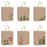 Brown paper christmas bags. Collection of brown paper bags with festive motifs Royalty Free Stock Images
