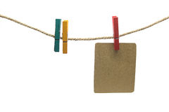 Brown paper clip on the rope Stock Images