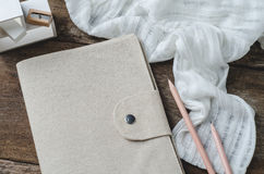 Brown paper diary with pencils, eraser and pencil sharpener on w Royalty Free Stock Image