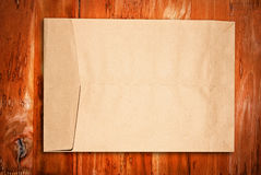 Brown paper envelope on wood. Brown paper Envelope on grunge wood wall Royalty Free Stock Images