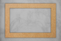 Brown paper frame on gray concrete. Royalty Free Stock Photos