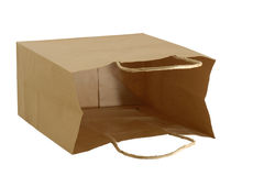 Brown paper gift bag. Isolated brown paper gift bag laying on it's side letting you see inside Stock Photos