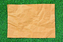 Brown paper on green grass Stock Image