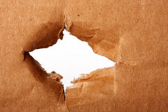 Brown paper with hole Stock Photo