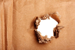 Brown paper with hole Stock Image