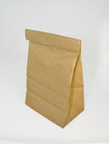 Brown paper lunch bag. With food Royalty Free Stock Image