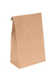 Brown paper lunch bag. A brown, folded-top paper lunch pag isolated on white Stock Images