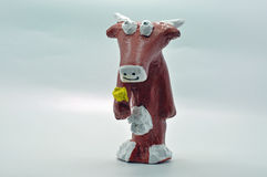 Brown paper mache cow Stock Photo