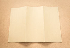 Brown paper note on business wood desk with copy space. Stock Photography