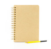 Brown paper notebook with yellow pencil isolated on white backgr Royalty Free Stock Images