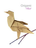 Brown paper origami twitter bird. On a branch Royalty Free Stock Photos