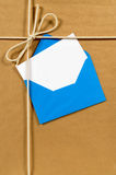 Brown paper package, address card or label, blue envelope, copy space Stock Image
