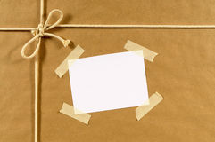 Brown paper package background, address label, sticky tape Royalty Free Stock Photos