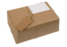 Brown paper package tied with string with  label Royalty Free Stock Photo