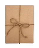 Brown paper package tied with string Stock Image