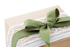 Brown paper package tied up with lace Royalty Free Stock Photos