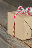 Brown paper package tied up with strings Stock Images