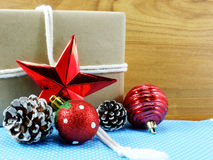 Brown paper package tied up with strings christmas present wrapped in recycled paper Royalty Free Stock Image