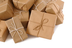 Pile or heap of brown paper packages isolated on white background Stock Image