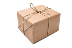Brown paper parcel. On the white background stock images