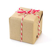 Brown paper parcel tied with red and white string Stock Photography