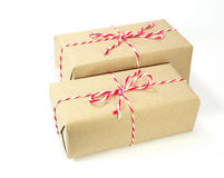 Brown paper parcel tied with red and white string Royalty Free Stock Photos