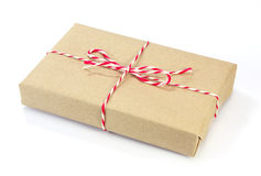 Brown paper parcel tied with red and white string Royalty Free Stock Photography