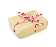 Brown paper parcel tied with red and white string Royalty Free Stock Images
