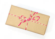 Brown paper parcel tied with red and white string Stock Image