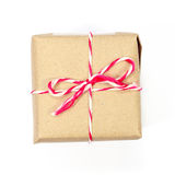 Brown paper parcel tied with red and white string Stock Images