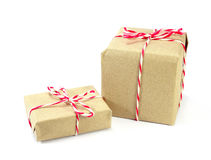 Brown paper parcel tied with red and white string on white backg Stock Images