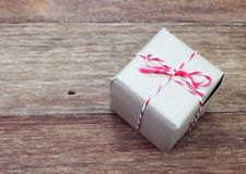 Brown paper parcel tied with red and white string Stock Photo