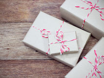 Brown paper parcel tied with red and white string Royalty Free Stock Photo