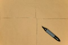Brown paper parcel tied up with string and pen. Stock Photos