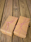 Brown paper parcels with red and white string Royalty Free Stock Image