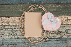 Brown paper rope and Heart gift box on vintage wood Royalty Free Stock Photos