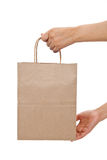 Brown paper shopping bag. With white background Stock Image