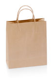 Brown paper shopping bag. A brown paper shopping bag isolated on white background Royalty Free Stock Photo