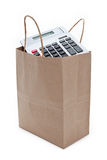Brown paper shopping bag and calculator. With white background royalty free stock photos