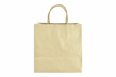 Brown paper shopping bag with handles over on white background. Stock Photo